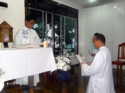 Arnold Garferio makes his Vows in front of Larry Sabud the Philippines District Superior